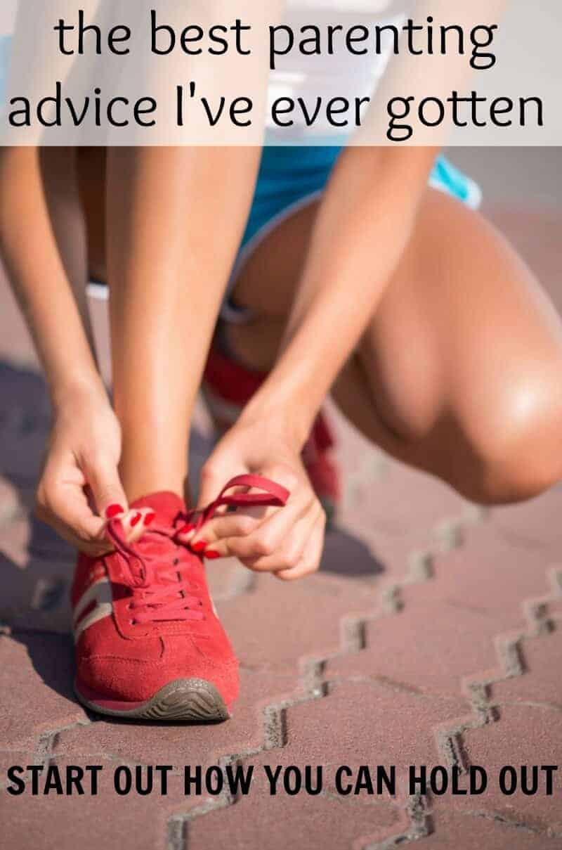 girl tying her bright red tennis shoes