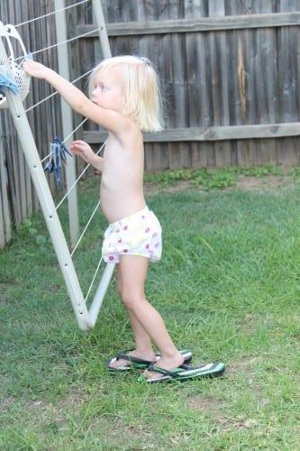 toddler at clothesline