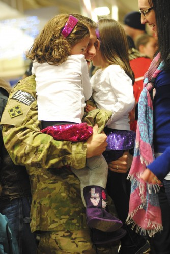daddy holding daughter deployment reunion