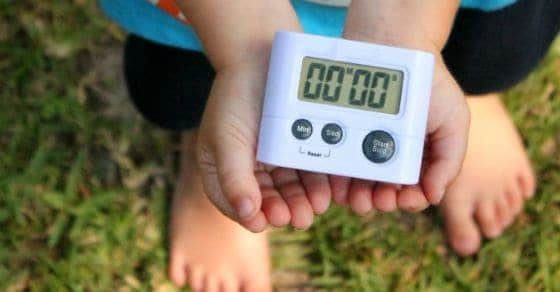 child holding a timer