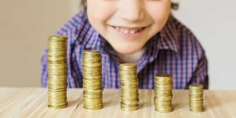 child learning money management skills, counting money