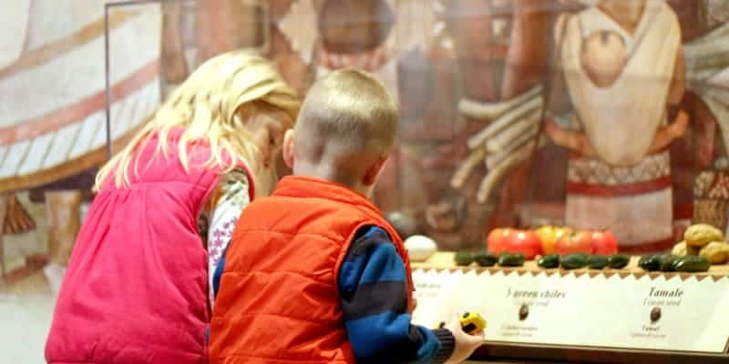 ella kate and judah looking at chocolate