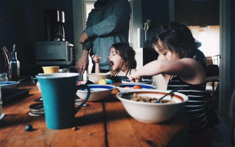kids eating breakfast at table not being picky
