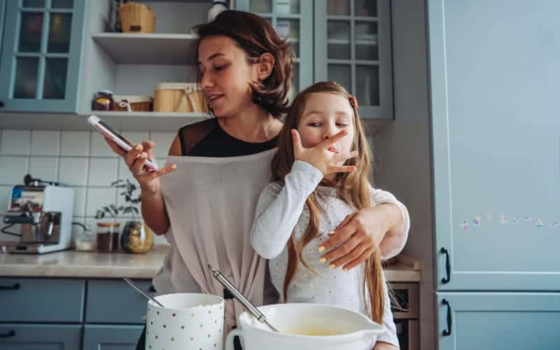 distracted mom baking with her child