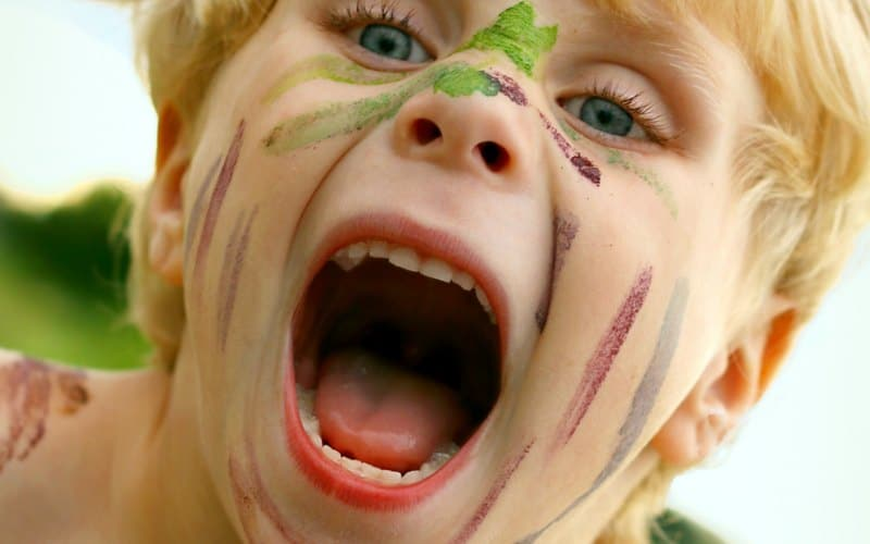 hyper kid with paint on face
