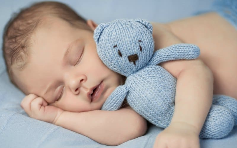 4 month old sleeping with blue teddy bear