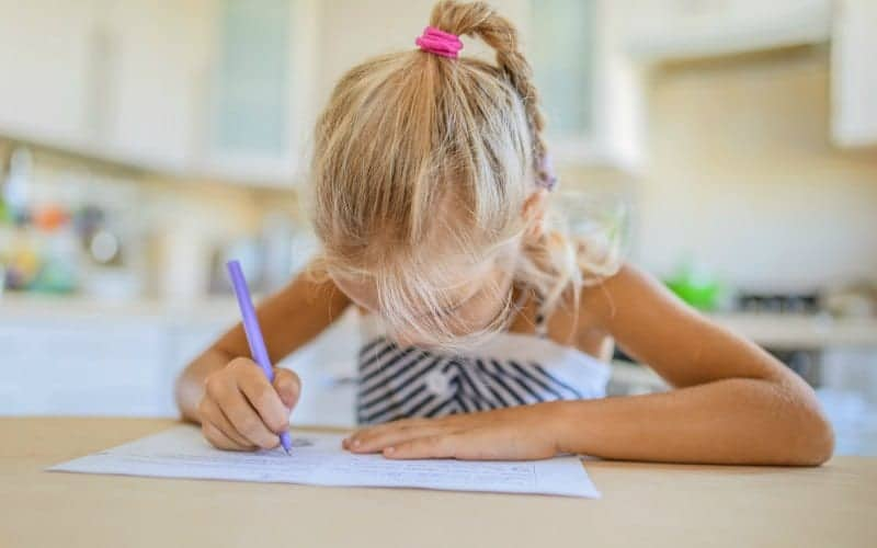 girl writing o a piece of paper