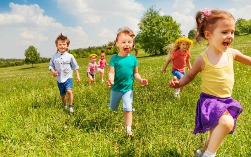 little kids having fun and running