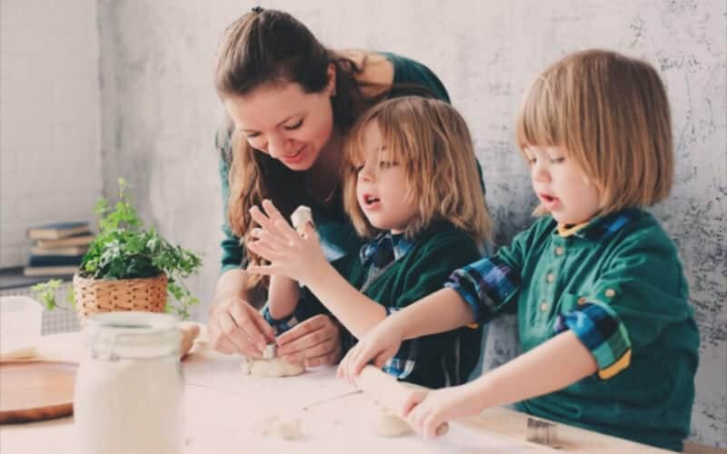 why oversharing our kids' private lives is not a good thing . mom with two kids in the kitchen