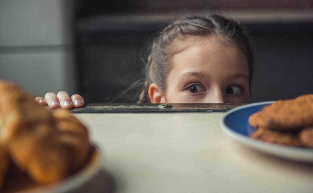 child looking at good food on table, not a picky eater