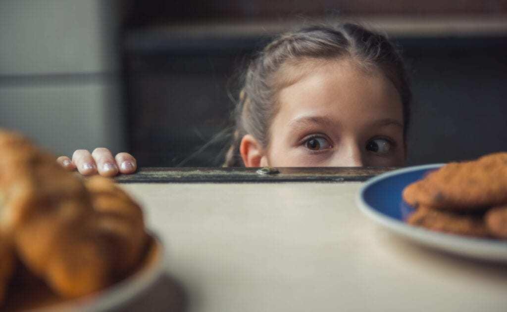 girl looking at food