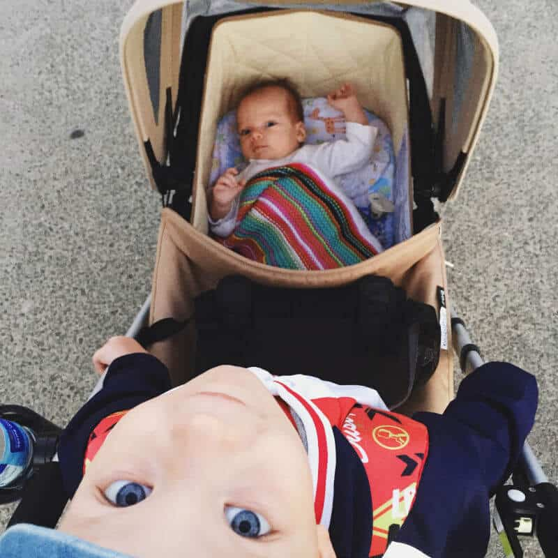 baby and toddler in tandem double stroller, for irish twins