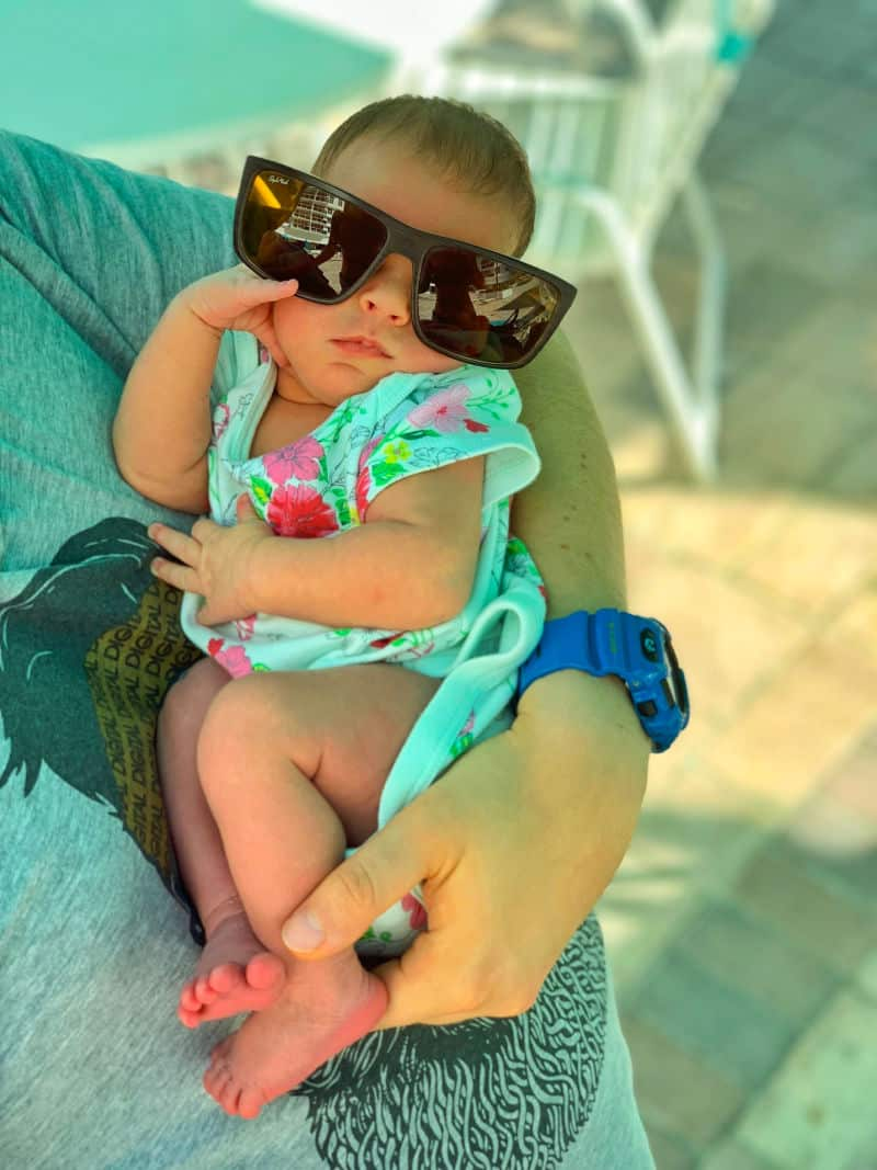 how to dress a newborn in summer, newborn with sunglasses on and mom holding