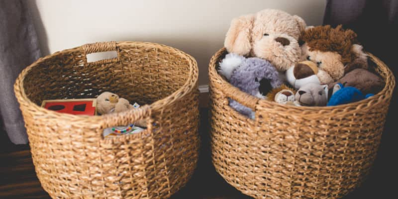 minimalist baskets on floor with kids toys
