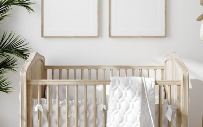 simple minimal crib in a nursery