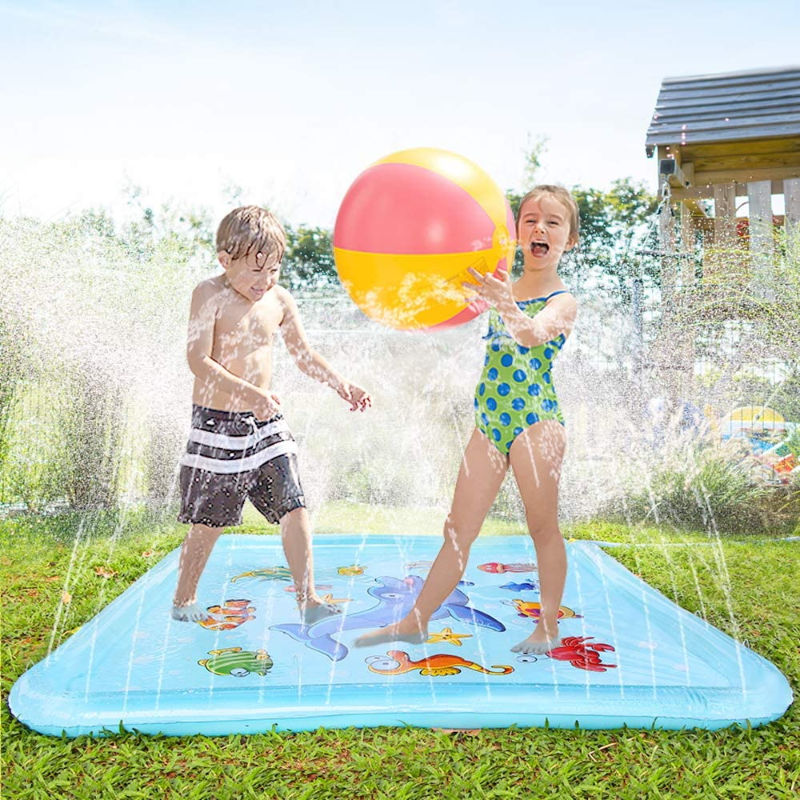 little kids playing outside on an outdoor splash pad