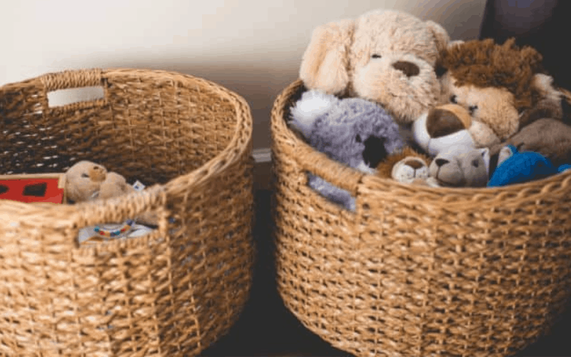 Mom uses basket to sweep through room and organize to get more done while kids are napping.