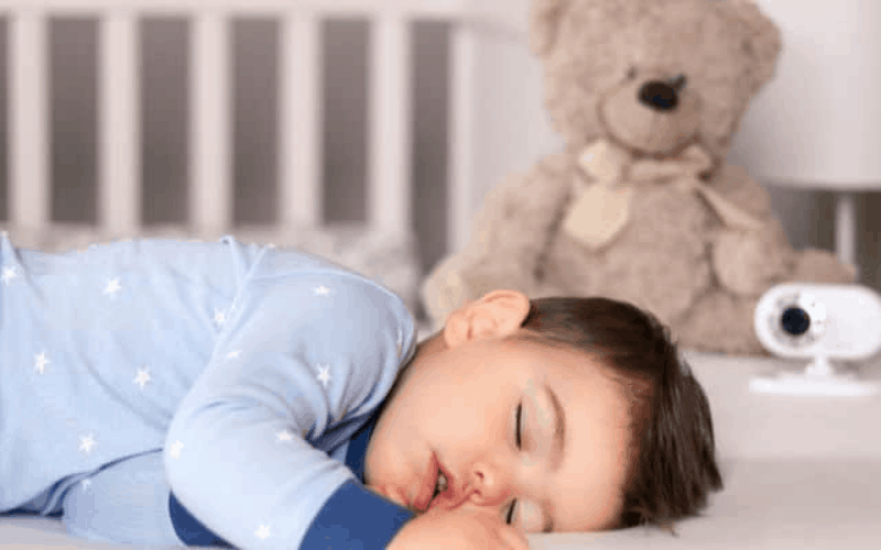 Boy napping with a monitor helps mom get more done while kids are napping.